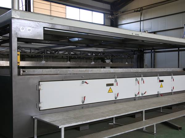 There is a plastic vacuum forming machine.