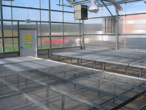 The glasshouse is installed with expanded metal benches.