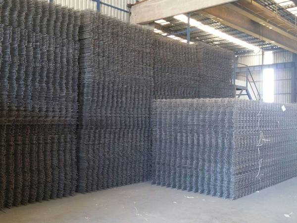 There are two stacks of neatly stored welded wire mesh panel.